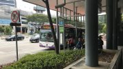 Street scene with bus stop in Geylang neighbourhood in Singapore
