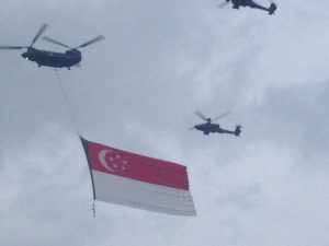Singapore helicopters carrying the Singapore flag
