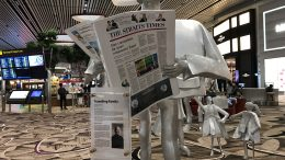 Straits Times reading sculpture at Changi Airport