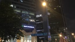 Singapore night-time street scene, with OUE building; taken August 2018.