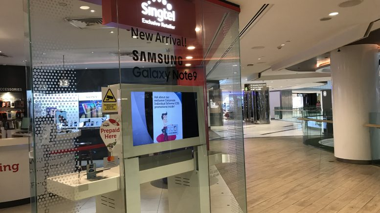 SingTel retail store at Raffles City Mall in Singapore; taken September 2018.