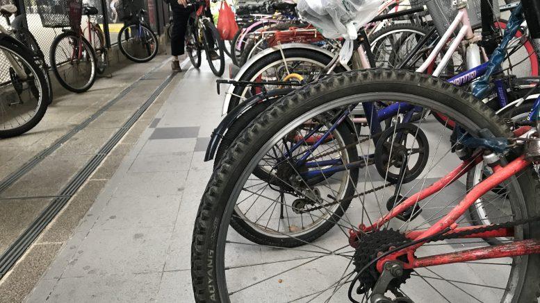 Public bicycle rack in Singapore neighborhood Paya Lebar; taken September 2018.
