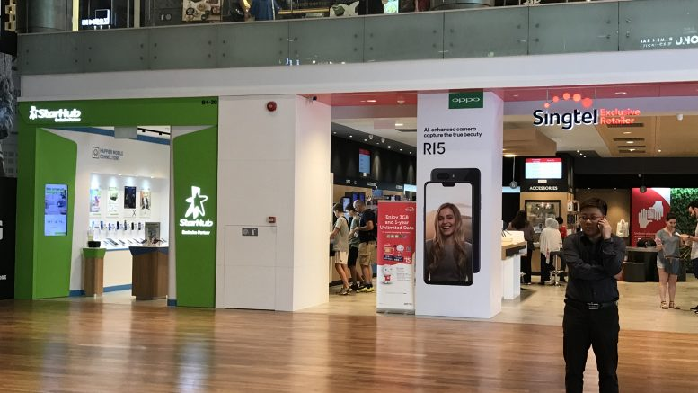 Singtel, StarHub and Hoshino Coffee retail outlets in Ion mall in Singapore; taken July 2018.