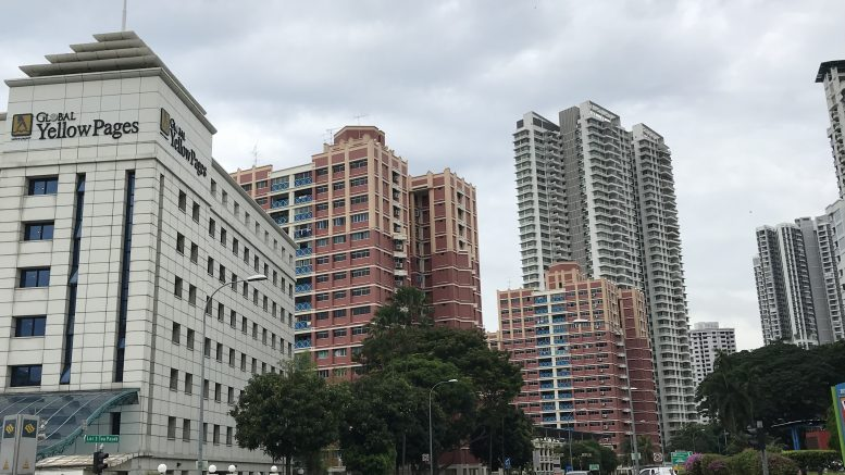 Singapore street scene at Braddell MRT with Global Yellow Pages building; taken July 2018.