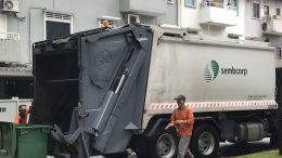 A Sembcorp Industries truck picks up refuse in Singapore's Geylang neighborhood; taken October 2018.