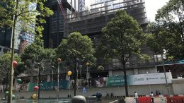 Ascendas-Singbridge signage at construction site near Tanjong Pagar MRT in Singapore's central business district.