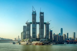 Raffles City Chongqing, under construction, with The Crystal skybridge above four 250-meter towers. Credit: CapitaLand.