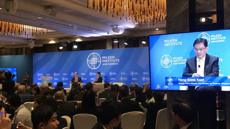 Singapore's Deputy Prime Minister Heng Swee Keat (right) speaks with financier and philanthropist Michael Milken (left) at the Milken Institute Asia Summit in Singapore on 19 September 2019.