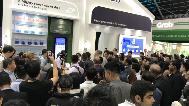 A crowd at Singapore Fintech Festival 2019 as Singapore's Prime Minister Lee Hsien Loong tours the booths.